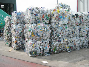 Mixed plastic bottles baled and ready for recycling